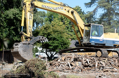 Demolition of houses along Warner Street is underway as well as construction at the location where Siskiyou Hall once stood on the CSUC campus Wednesday July 18, 2018. (Bill Husa -- Enterprise-Record)