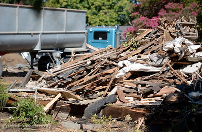 Demolition of a house near Brice Ave. and Warner Street is underway as well as construction at the location where Siskiyou Hall once stood on the CSUC campus Wednesday July 18, 2018. (Bill Husa -- Enterprise-Record)