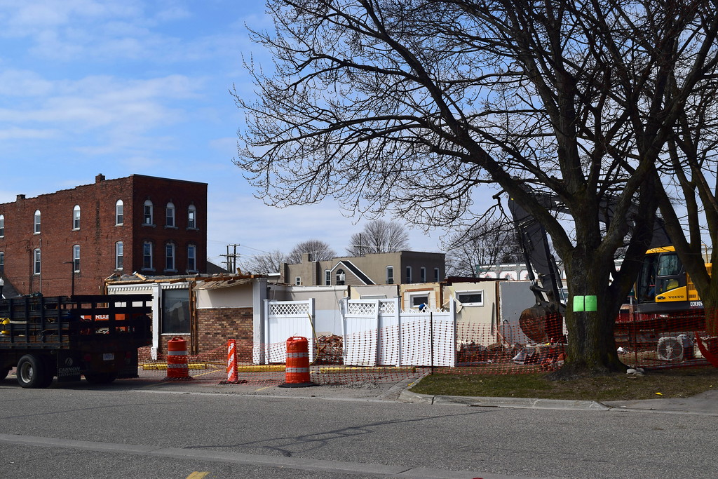 . The demolition of two vacant buildings in downtown New Baltimore is clearing the way for potential new development. The city\'s old police station building at Washington and Front streets, along with an adjacent house, were razed. (Photos by Katelyn Larese)