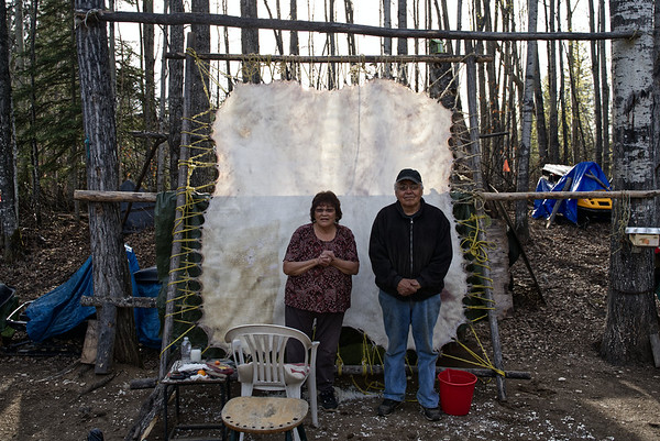 Lucy Didzina and Charlie McCarthy working on a moose-hide in their backyard.