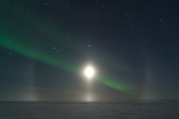 Aurora and moon halo over Great Bear Lake.