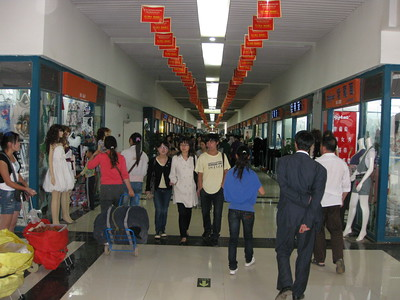 One of many alleys in the wholesale mall.  There are at least 10+ rows on each floor and many many stores in each row.