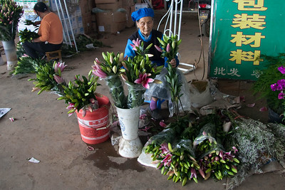 Lady selling Stargazer Lilies.  They are real inexpensive, maybe $1USD a stem.