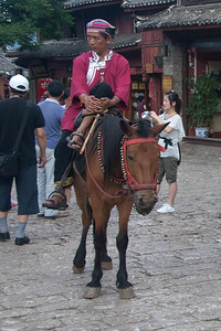 Naxi cowboy?  Notice how small the horse is.