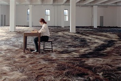 Types and colours of denim or offcuts laid out in colours across the floor of his space?