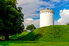 aA view of the white tower long the Vold military embankment ramparts in Fredericia, Denmark.