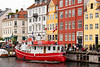 Colorful townhouses along a canal in the Nyhavn district of Copenhagen, Denmark.