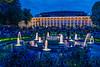 The Tivoli Gardens Concert Hall and fountains illuminated at night in Copenhagen, Denmark.