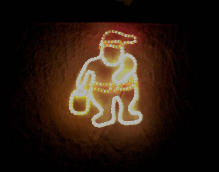 An illuminated Santa Claus on the wall of our house, 2006. Taken with a Sigma 30mm f1.4 lens.