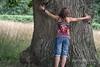 Girl hugging a huge tree, Fredensborg Palace garden, Denmark