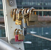 Some of the padlocks have smaller padlocks attached to them.