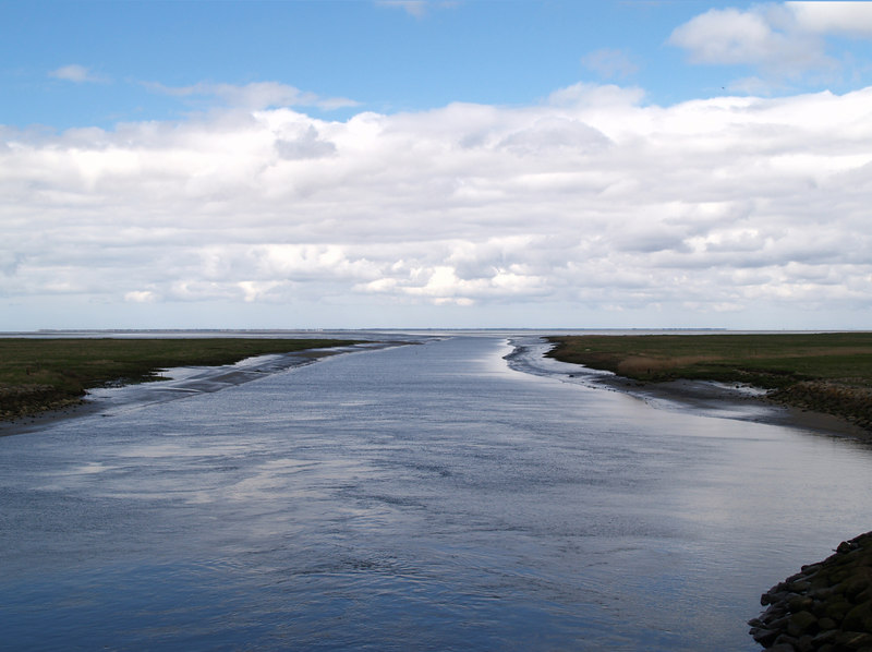 The Ribe River flowing into the North Sea, as seen from the locks where the river flows through the dyke.