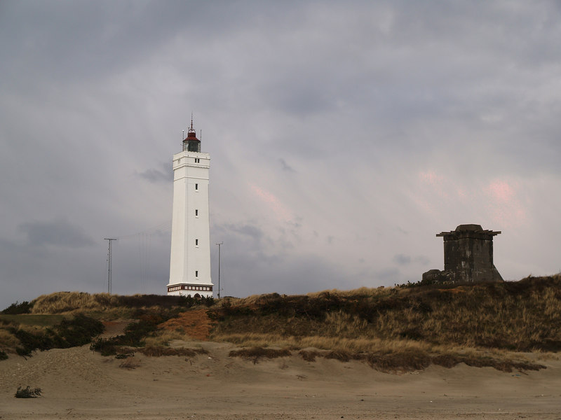 The light house at Blåvand. The structure to the right is the remains of the foundation of a German canon from WW II.