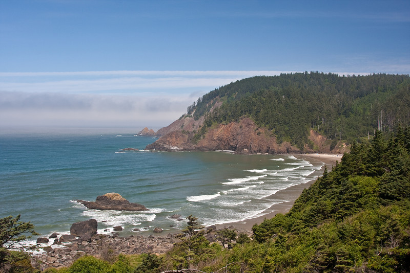Looking north across Indian Beach on the Oregon coast, with a small layer of clouds just off the coast.