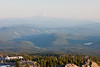 Looking south from about 7000 feet on Mt Hood toward Mt Jefferson. Timberline Lodge is in the lower left. The lake in the foreground is Trillium Lake, and farther away is Timothy Lake.