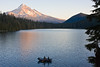 The last boat on Lost Lake, not long before sunset. Mt Hood is in the distance.