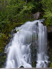 A roadside waterfall on the way up from highway 26 to Timberline Lodge on Mt Hood, Oregon.