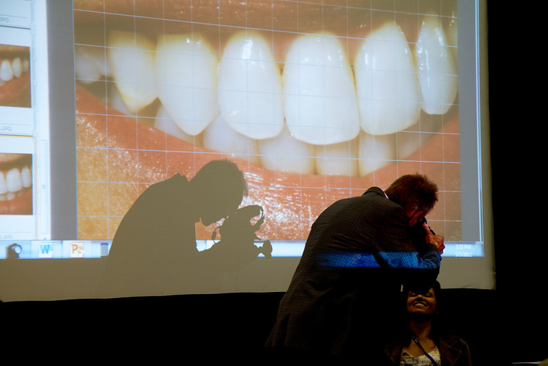 Dr Young casts a dramatic shadow when shooting intraoral photos