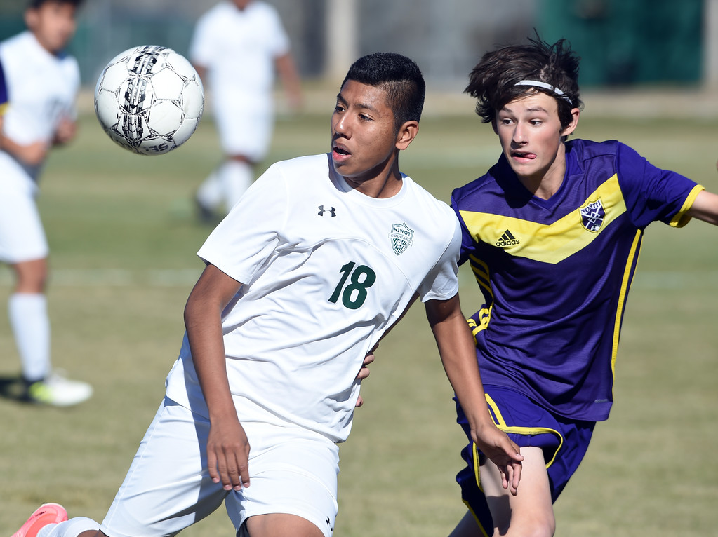 . Jonathan Jimenez Flores, of Niwot, and Fergus Sarapura, of Denver North, track down the ball at Niwot High School on Saturday. Cliff Grassmick  Photographer November 4, 2017