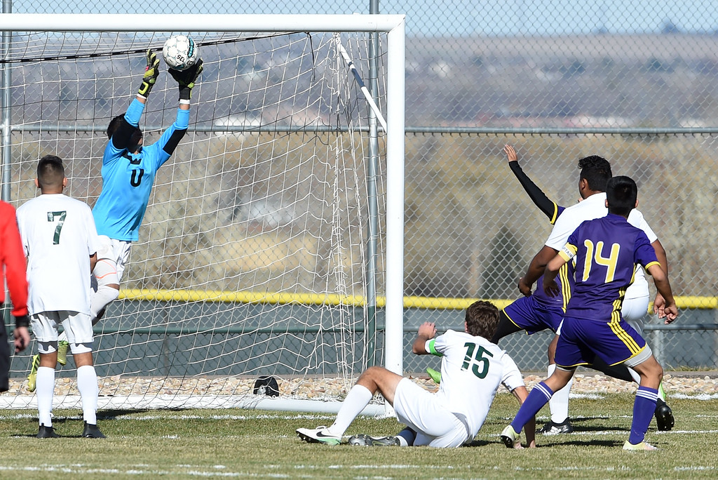 . Mario Munoz, of Niwot, makes a save against Denver North at Niwot High School on Saturday. Cliff Grassmick  Photographer November 4, 2017
