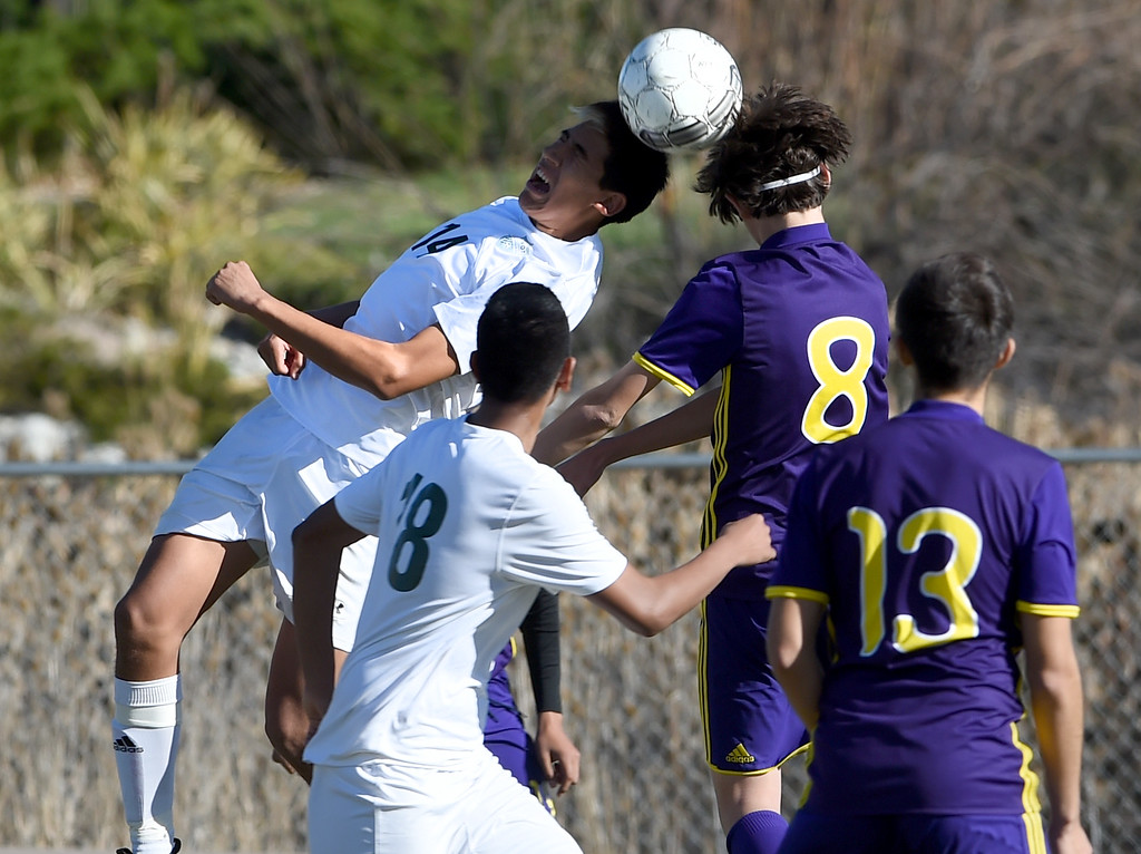 . Manuel Tapia, left, of Niwot, and Fergus Sarapura, of Denver North, connect on a header at Niwot High School on Saturday. Cliff Grassmick  Photographer November 4, 2017