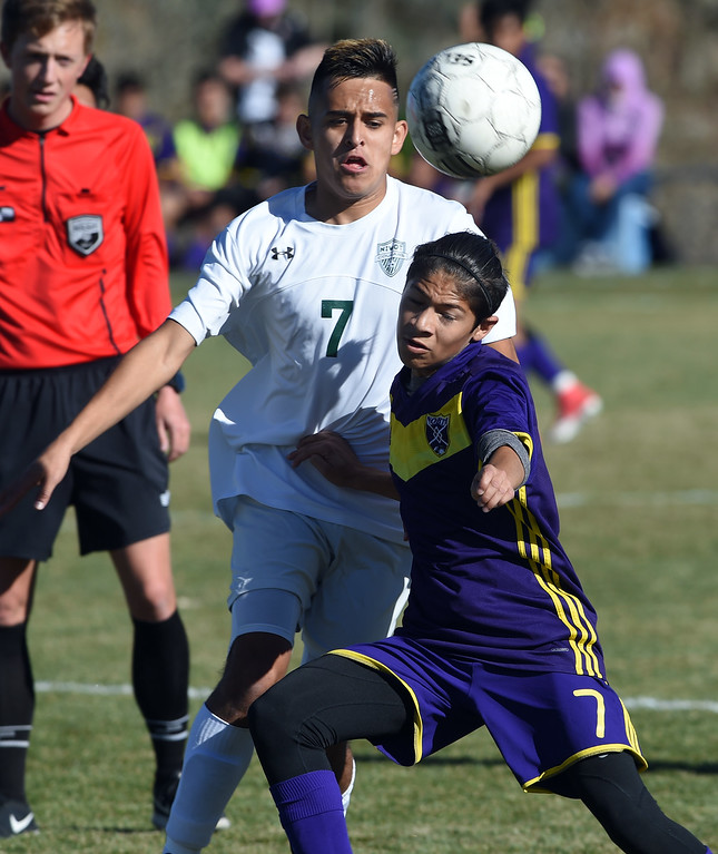 . Jason Rodriguez, of Niwot, and Jonathan Gonzales, of Denver North, battle for the ball at Niwot High School on Saturday. Cliff Grassmick  Photographer November 4, 2017