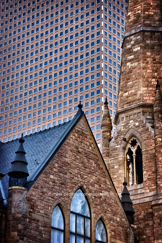 Trinity Methodist (1888) and Wells Fargo Center (Cash Register Building (1983).<br /> Where Broadway, Tremont Pl. and 18th. street intersect <br /> Urban abstract