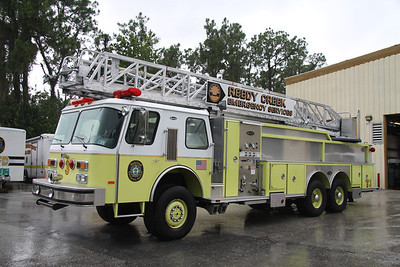 Reedy Creek Fire Rescue FL (Disney World) Truck 3, 1990 Emergency One 65' 250GPM/200 all wheel drive quint.  This truck is set up to respond off road to remote areas for access to the mono-rail.