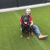 Severus, a giant lap dog, enjoying snuggle time with volunteer Brad