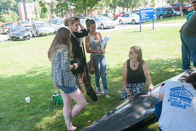 Karen Vorwerk's math class taking measurements to graph and describe the buoyancy of a racing canoe at Westfield State University