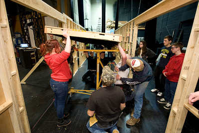 Students from Westfield Vocational High School deiver and install pieces of the set they constructed for Dever Stage's production of Cabaret at Westfield State University