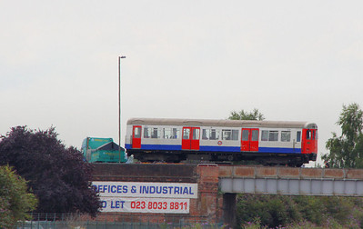 Metropolitian Tube Stock Driving Car No 5157 crosses Campbell Road Bridge into Eastleigh Works on a low loader 26/07/11