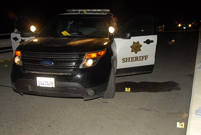Evidence markers are placed around a sheriff's patrol vehicle at the scene of the shooting. (Humboldt County Sheriff's Office - Contributed)