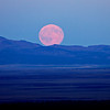 The full moon rises over the Maury Mountains