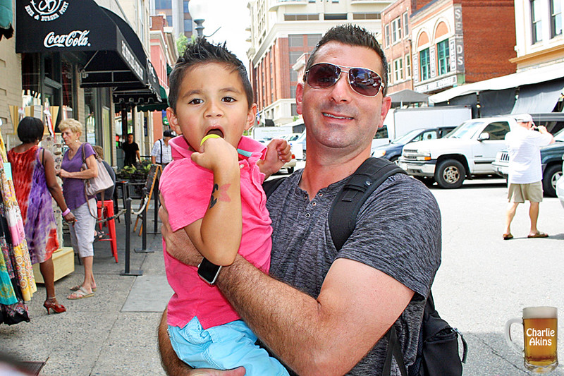 I saw this father and son while walking downtown.