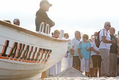 Lavallette beach patrol member, Scott Darby [on left]. The Blessing of the Sea in Lavallette, NJ on 8/15/19. [DANIELLA HEMINGHAUS]