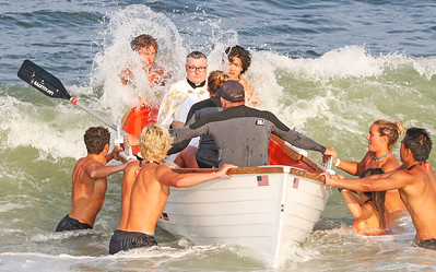 Pastor Rev. Douglas Freer [center] being brought ashore by members of the Lavallette beach patrol. The Blessing of the Sea in Lavallette, NJ on 8/15/19. [DANIELLA HEMINGHAUS]