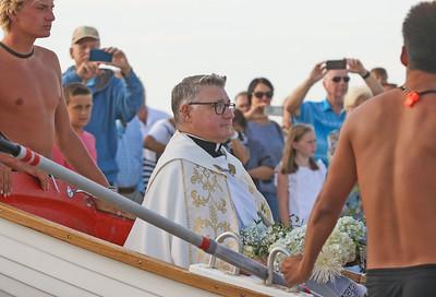 Pastor Rev. Fthr. Douglas Freer [center] The Blessing of the Sea in Lavallette, NJ on 8/15/19. [DANIELLA HEMINGHAUS]