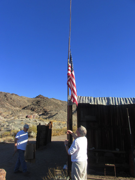 Lowering of the flag, alerting others that the cabin is unoccupied.