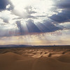 """Heavenly Light"" - dramatic photo of sun rays highlighting a small area of Glamis Sand Dunes"