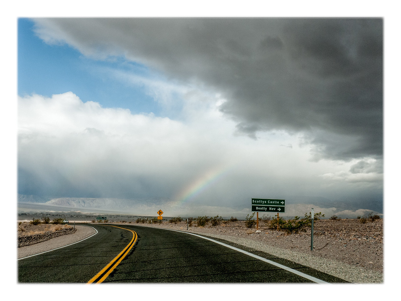 A rainbow glows up ahead.