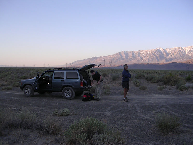 Jean Philippe (JP) arms folded gazing at the Sierra. Ryan is organizing gear.