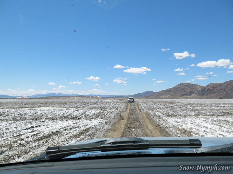 "May 1, 2016  Crossing ""a not so dry"" Soda Lake.  It was thick, slippery, salty mud!  Keep speed up, don't stop, quit sliding!"
