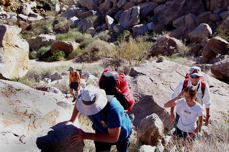 A short way past the palm grove the trail turned into boulder hopping. Ray and the kids turned back at this point.