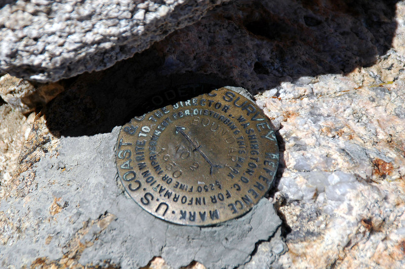 One of the three benchmarks on the peak.