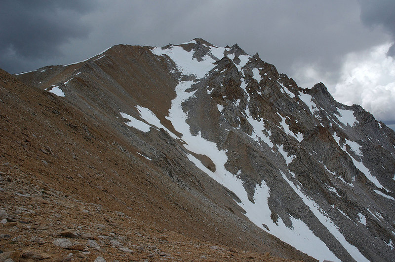 Looking at the peak from the second saddle. Kathy is somewhere up ahead. Things are starting to get real dark up here.
