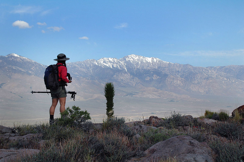 Cori looking towards Olancha Peak to the northwest from the saddle.