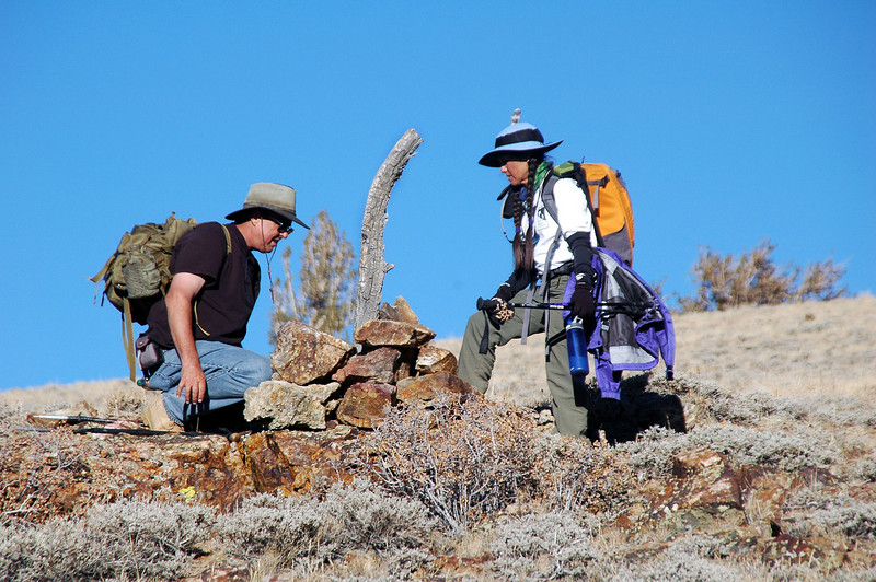 Tom and Cori checking out a mining claim marker. We never did find the cabin.