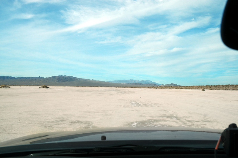 Driving on Soda Lake as we head to Little Cowhole Mountain.