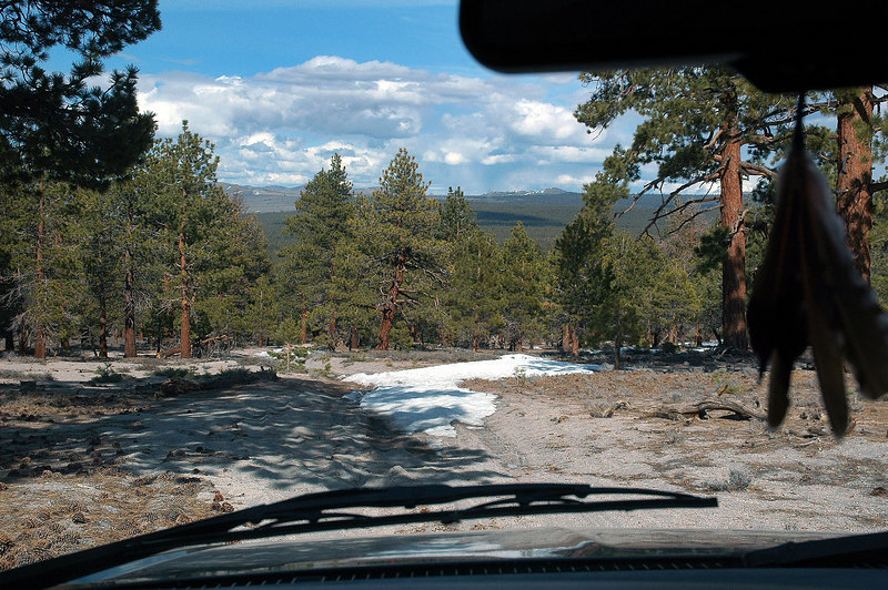 Driving down to the main dirt road that runs along the east side of the craters. About to cross one of the three small snow patches on this section of road.